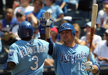 KANSAS CITY, MO - JULY 28:  Billy Butler #16 of the Kansas City Royals congratulates Yuniesky Betancourt #3 after a run during the game against  the Minnesota Twins on July 28, 2010 at Kauffman Stadium in Kansas City, Missouri.  (Photo by Jamie Squire/Get