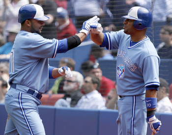 TORONTO - APRIL 21: Alex Gonzalez #11 and Vernon Wells #10 of the Toronto Blue Jays celebrate Gonzalez's run against the Kansas City Royals during a MLB game at the Rogers Centre April 21, 2010 in Toronto, Ontario, Canada. (Photo by Abelimages / Getty Ima