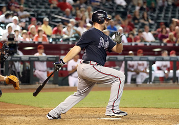 PHOENIX - JUNE 10:  Brian McCann #16 of the Atlanta Braves hits a RBI single against the Arizona Diamondbacks during the ninth inning of the Major League Baseball game at Chase Field on June 10, 2010 in Phoenix, Arizona. The Braves defeated the Diamondbac