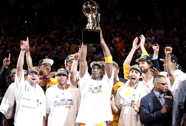 LOS ANGELES, CA - JUNE 17:  Kobe Bryant #24 of the Los Angeles Lakers holds up the Larry O'Brien trophy after the Lakers defeated the Boston Celtics in Game Seven of the 2010 NBA Finals at Staples Center on June 17, 2010 in Los Angeles, California.  NOTE
