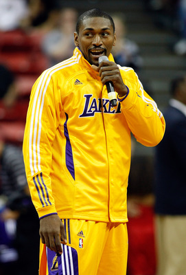 LAS VEGAS - OCTOBER 13:  Ron Artest #15 of the Los Angeles Lakers addresses the crowd before a preseason game against the Sacramento Kings at the Thomas & Mack Center October 13, 2010 in Las Vegas, Nevada. The Lakers won 98-95. NOTE TO USER: User expressl