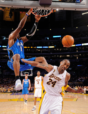 LOS ANGELES, CA - JUNE 07:  Dwight Howard #12 of the Orlando Magic dunks the ball over Kobe Bryant #24 of the Los Angeles Lakers in Game Two of the 2009 NBA Finals at Staples Center on June 7, 2009 in Los Angeles, California. NOTE TO USER: User expressly