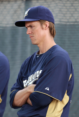 PHOENIX, AZ - FEBRUARY 18:  Pitcher Zack Greinke #13 of the Milwaukee Brewers warms up during a MLB spring training practice at Maryvale Baseball Park on February 18, 2011 in Phoenix, Arizona.  (Photo by Christian Petersen/Getty Images)
