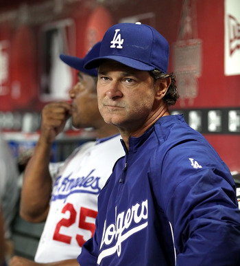 PHOENIX - SEPTEMBER 24:  Don Mattingly of the Los Angeles Dodgers sits in the dugout during the Major League Baseball game against the Arizona Diamondbacks at Chase Field on September 24, 2010 in Phoenix, Arizona.   The Dodgers defeated the Diamondbacks 3