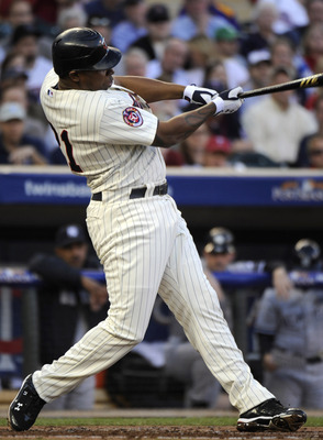 MINNEAPOLIS, MN - OCTOBER 7: Delmon Young #21 of the Minnesota Twins singles during game two of the ALDS game against the New York Yankees on October 7, 2010 at Target Field in Minneapolis, Minnesota.  (Photo by Hannah Foslien/Getty Images)