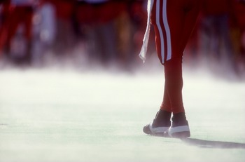 30 OCT 1993:  A GENERAL VIEW OF A NEBRASKA PLAYER''S LEGS ON A MIST-COVERED FIELD IN BOULDER, CO. Mandatory Credit: Tim Defrisco/ALLSPORT