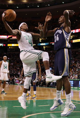 BOSTON - MARCH 10:  Rajon Rondo #9  of the Boston Celtics heads for the net as Hasheem Thabeet #34 of the Memphis Grizzlies defends on March 10, 2010 at the TD Garden in Boston, Massachusetts. The Grizzlies defeated the Celtics 111-91. NOTE TO USER: User