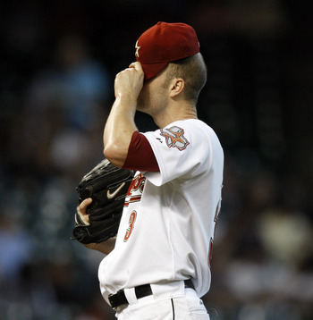 HOUSTON - SEPTEMBER 15:  Pitcher J.A. Happ #30 of the Houston Astros wipes his face after allowing three runs  against the Milwaukee Brewers in the first inning at Minute Maid Park on September 15, 2010 in Houston, Texas.  (Photo by Bob Levey/Getty Images