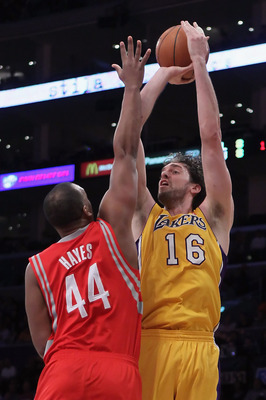 LOS ANGELES, CA - FEBRUARY 01:  Pau Gasol #16 of the Los Angeles Lakers shoots over Chuck Hayes #44 of the Houston Rockets in the first half at Staples Center on February 1, 2011 in Los Angeles, California. The Lakers defeated the Rockets 114-106. NOTE TO