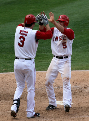 ANAHEIM, CA - SEPTEMBER 29:   Jeff Mathis #5 of the Los Angeles Angels of Anaheim is greeted by Brandon Wood #3 of the Oakland Athletics as Mathis scores the winning run on September 29, 2010 at Angel Stadium in Anaheim, California. The Angels won 2-1 in