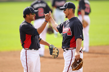 LAKE BUENA VISTA, FL - FEBRUARY 21:  Martin Prado #14 and Chipper Jones #10 of the Atlanta Braves high five during a spring training workout at Champion Stadium on February 21, 2011 in Lake Buena Vista, Florida.  (Photo by Mike Ehrmann/Getty Images)