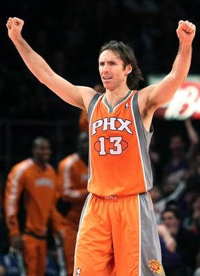 NEW YORK, NY - JANUARY 17:  Steve Nash #13 of the Phoenix Suns celebrates a basket against the New York Knicks at Madison Square Garden on January 17, 2011 in New York City. NOTE TO USER: User expressly acknowledges and agrees that, by downloading and or