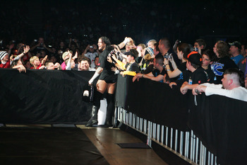 SYDNEY, AUSTRALIA - JUNE 15:  CM Punk celebrates with fans before facing Shelton Benjamin during WWE Smackdown at Acer Arena on June 15, 2008 in Sydney, Australia.  (Photo by Gaye Gerard/Getty Images)