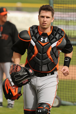 SCOTTSDALE, AZ - FEBRUARY 19:  Buster Posey #28 of the San Francisco Giants heads back to the plate after talking to one of the pitchers during live batting practice at Scottsdale Stadium on February 19, 2011 in Scottsdale, Arizona.  (Photo by Norm Hall/G