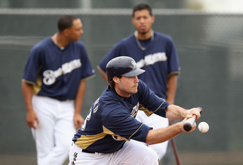 PHOENIX, AZ - FEBRUARY 18:  Pitcher Tim Dillard #48 of the Milwaukee Brewers participates in bunting drills during a MLB spring training practice at Maryvale Baseball Park on February 18, 2011 in Phoenix, Arizona.  (Photo by Christian Petersen/Getty Image