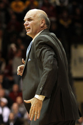 PHILADELPHIA, PA - DECEMBER 08:  Head coach Phil Martelli of the St. Joseph's Hawks reacts as he coaches in the second half against the Minnesota Golden Gophers at Michael J. Hagan Arena on December 8, 2010 in Philadelphia, Pennsylvania.  (Photo by Chris