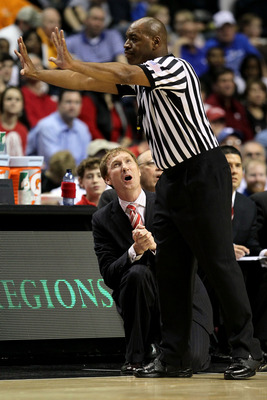 NASHVILLE, TN - MARCH 11:  Head coach John Pelphrey of the Arkanasas Razorbacks reacts to a call by the referee against the Georgia Bulldogs during the first round of the SEC Men's Basketball Tournament at the Bridgestone Arena on March 11, 2010 in Nashvi