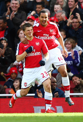 LONDON - MARCH 14: Andrei Arshavin and Theo Walcott of Arsenal celebrate their team's first goal scored by Arshavin during the Barclays Premier League match between Arsenal and Blackburn Rovers at Emirates Stadium on March 14, 2009 in London, England.  (P