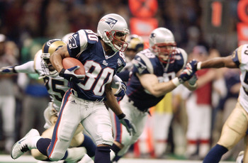 03 Feb 2002:   Troy Brown of the New England Patriots cradles the ball as he heads downfield against the St.Louis Rams during Superbowl XXXVI at the Superdome in New Orleans, Louisiana.  The Patriots won 20-17, with a 48-yard field goal by kicker Adam Vin