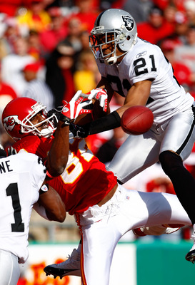 KANSAS CITY, MO - NOVEMBER 25:  Nnamdi Asomugha #21 of the Oakland Raiders breaks up a pass intended for Dwayne Bowe #82 of the Kansas City Chiefs during the game on November 25, 2007 at Arrowhead Stadium in Kansas City, Missouri.  (Photo by Jamie Squire/