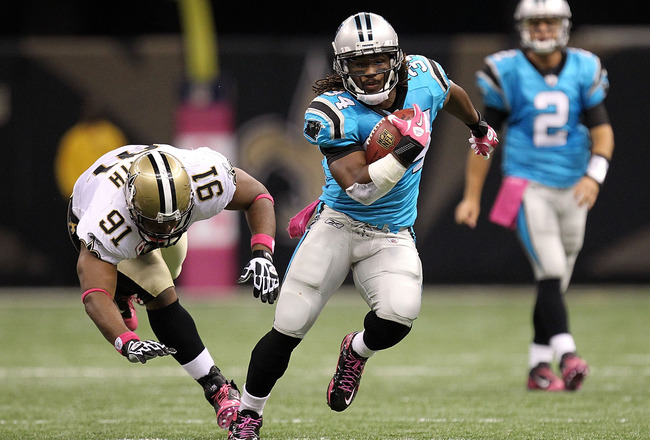 NEW ORLEANS - OCTOBER 03:  Running back DeAngelo Williams #34 of the Carolina Panthers runs for a touchdown past Will Smith #91 of the New Orleans Saints at the Louisiana Superdome on October 3, 2010 in New Orleans, Louisiana.  (Photo by Ronald Martinez/G