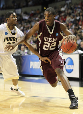 SPOKANE, WA - MARCH 21:  Khris Middleton #22 of the Texas A&M  Aggies drives against E'Twaun Moore #33 of the Purdue Boilermakers during the second round of the 2010 NCAA men's basketball tournament at the Spokane Arena on March 21, 2010 in Spokane, Washi