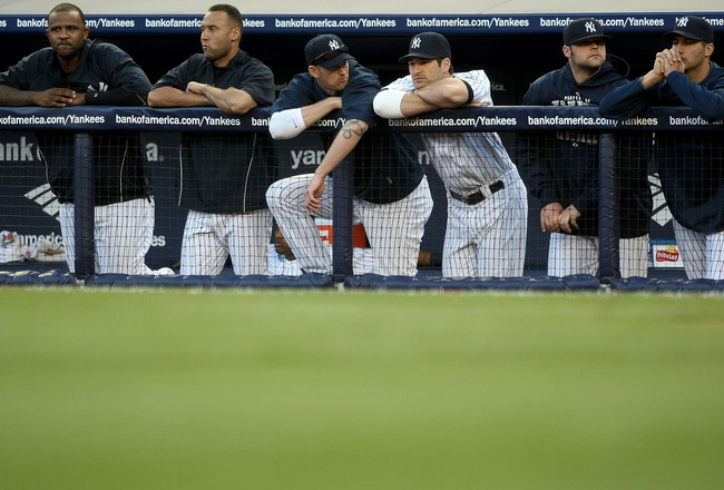 NEW YORK - APRIL 18: (L-R) CC Sabathia, Derek Jeter, A.J. Burnett, Xavier Nady, Joba Chamberlain and Andy Pettitte of the New York Yankees watch on from the dugout as they are defeated 22-4 by the Cleveland Indians at Yankee Stadium on April 18, 2009 in t