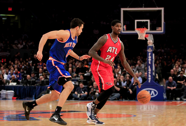 NEW YORK, NY - FEBRUARY 16:  Marvin Williams #24  of the Atlanta Hawks dribbles against Landry Fields #6 of the New York Knicks at Madison Square Garden on February 16, 2011 in New York City. NOTE TO USER: User expressly acknowledges and agrees that, by d