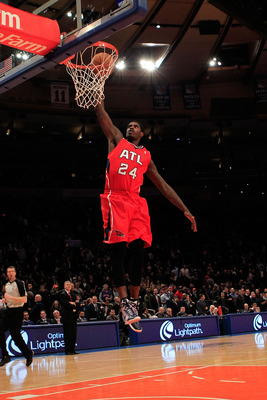 NEW YORK, NY - FEBRUARY 16: Marvin Williams #24 of the Atlanta Hawks lays the ball up against the New York Knicks at Madison Square Garden on February 16, 2011 in New York City. NOTE TO USER: User expressly acknowledges and agrees that, by downloading and