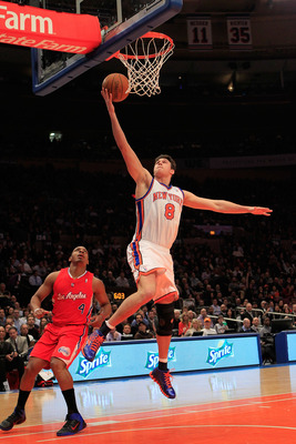 NEW YORK, NY - FEBRUARY 09: Danilo Gallinari #8 of the New York Knicks lays the ball up over Randy Foye #4 of the Los Angeles Clippers at Madison Square Garden on February 9, 2011 in New York City. NOTE TO USER: User expressly acknowledges and agrees that
