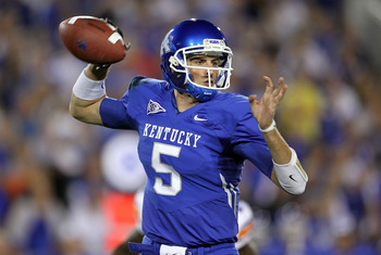 LEXINGTON, KY - OCTOBER 09:  Mike Hartline #5 of the Kentucky Wildcats throws a pass during the SEC game against  the Auburn Tigers  at Commonwealth Stadium on October 9, 2010 in Lexington, Kentucky.  (Photo by Andy Lyons/Getty Images)
