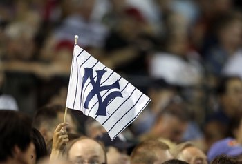 PHOENIX - JUNE 23:  Fans of the New York Yankees hold up a flag during the Major League Baseball game against the Arizona Diamondbacks at Chase Field on June 23, 2010 in Phoenix, Arizona.  The Yankees defeated the Diamondbacks 6-5 in ten innings.  (Photo