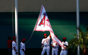 ANAHEIM, CA - APRIL 06:  (L-R) Scot Shields #62, Chone Figgins #9, Vladimir Guerrero #27, Robb Quinlan #39 and Torii Hunter #48 of the Los Angeles Angels of Anaheim help to raise The 2008 American League Western Division Championship flag prior to the sta