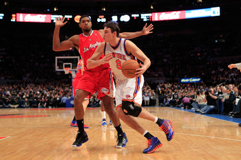 NEW YORK, NY - FEBRUARY 09:  Danilo Gallinari #8 of the New York Knicks drives against Ryan Gomes #15 of the Los Angeles Clippers at Madison Square Garden on February 9, 2011 in New York City. NOTE TO USER: User expressly acknowledges and agrees that, by
