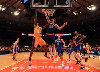 NEW YORK, NY - FEBRUARY 11:  Ron Artest #15 of the Los Angeles Lakers shoots over Timofey Mozgov #25 the New York Knicks at Madison Square Garden on February 11, 2011 in New York City. NOTE TO USER: User expressly acknowledges and agrees that, by download