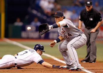 ST. PETERSBURG - JULY 27:  First baseman Miguel Cabrera #24 of the Detroit Tigers takes the throw as infielder Evan Longoria #3 of the Tampa Bay Rays gets back safely during the game at Tropicana Field on July 27, 2010 in St. Petersburg, Florida.  (Photo