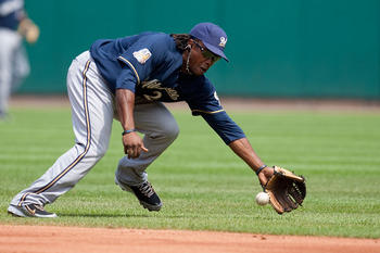 ST. LOUIS - AUGUST 18: Rickie Weeks #23 of the Milwaukee Brewers fields a ground ball against the St. Louis Cardinals at Busch Stadium on August 18, 2010 in St. Louis, Missouri.  The Brewers beat the Cardinals 3-2.  (Photo by Dilip Vishwanat/Getty Images)