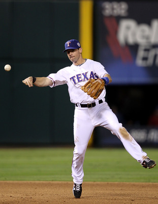 ARLINGTON, TX - OCTOBER 31:  Michael Young #10 of the Texas Rangers throws to first for the out against the San Francisco Giants in Game Four of the 2010 MLB World Series at Rangers Ballpark in Arlington on October 31, 2010 in Arlington, Texas.  (Photo by