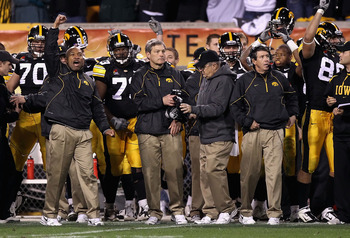 TEMPE, AZ - DECEMBER 28:  Head coach Kirk Ferentz (C) of the Iowa Hawkeyes celebrates with teammates after defeating the Missouri Tigers in the Insight Bowl at Sun Devil Stadium on December 28, 2010 in Tempe, Arizona.  The Hawkeyes defeated the Tigers 27-