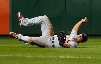 PITTSBURGH - SEPTEMBER 21:  Matt Holliday #7 of the St. Louis Cardinals catches a fly ball in left field against the Pittsburgh Pirates during the game on September 21, 2010 at PNC Park in Pittsburgh, Pennsylvania.  (Photo by Jared Wickerham/Getty Images)