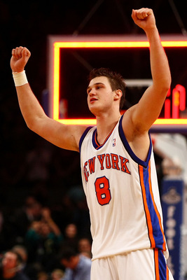 NEW YORK - JANUARY 07:  Danilo Gallinari #8 of the New York Knicks celebrates victory over the Charlotte Bobcats at Madison Square Garden January 7, 2010 in New York City. NOTE TO USER: User expressly acknowledges and agrees that, by downloading and/or us