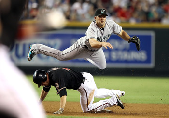 PHOENIX - JULY 10:  Infielder Dan Uggla #6 of the Florida Marlins throws over the sliding Rusty Ryal #4 of the Arizona Diamondbacks to complete a double play during the second inning of the Major League Baseball game at Chase Field on July 10, 2010 in Pho