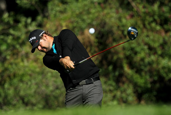 PACIFIC PALISADES, CA - FEBRUARY 20:  Ryan Moore hits his tee shot on the 12th hole during the final round of the Northern Trust Open at Riviera Country Club on February 20, 2011 in Pacific Palisades, California. Couples double bogeyed the hole.  (Photo b