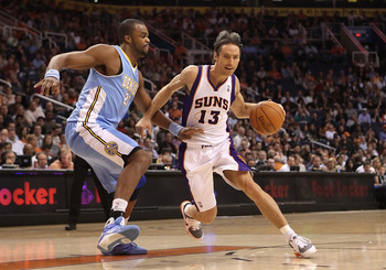 PHOENIX - NOVEMBER 15:  Steve Nash #13 of the Phoenix Suns handles the ball under pressure from Shelden Williams #23 of the Denver Nuggets during the NBA game at US Airways Center on November 15, 2010 in Phoenix, Arizona. The Suns defeated the Nuggets 100