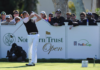 PACIFIC PALISADES, CA - FEBRUARY 20:  Aaron Baddeley of Australia plays his tee shot on the 17th hole during the final round of the Northern Trust Open at Riviera Country Club on February 20, 2011 in Pacific Palisades, California.  (Photo by Stuart Frankl