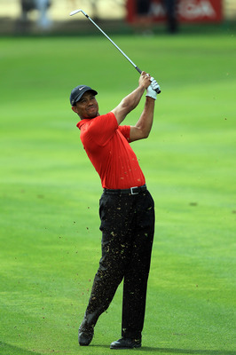 DUBAI, UNITED ARAB EMIRATES - FEBRUARY 13:  Tiger Woods of the USA plays his second shot at the par 4, 1st hole during the final round of the 2011 Omega Dubai Desert Classic on the Majilis Course at the Emirates Golf Club on February 13, 2011 in Dubai, Un