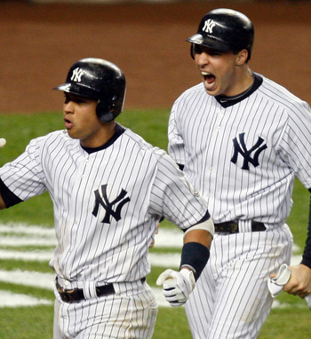 NEW YORK - NOVEMBER 04:   Mark Teixeira #25 and Alex Rodriguez #13 (L) of the New York Yankees celebrate after they scored on a 2-run double by Hideki Matsui #55 in the bottom of the fifth inning against the Philadelphia Phillies in Game Six of the 2009 M
