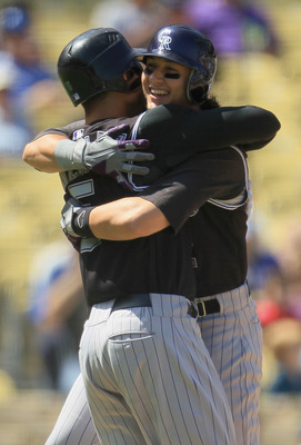 LOS ANGELES, CA - SEPTEMBER 18:  Troy Tulowitzki(R) #2 of the Colorado Rockies is congratulated by teammate Carlos Gonzalez (L) #5 after hitting a two-run home run against the Los Angeles Dodgers in the first inning at Dodger Stadium on September 18, 2010