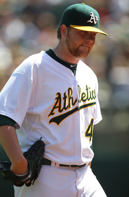 OAKLAND, CA - APRIL 18:  Brett Anderson #49 of the Oakland Athletics walks back to the dugout against the Baltimore Orioles after the fifth inning during an MLB game at the Oakland-Alameda County Coliseum on April 18, 2010 in Oakland, California.  (Photo
