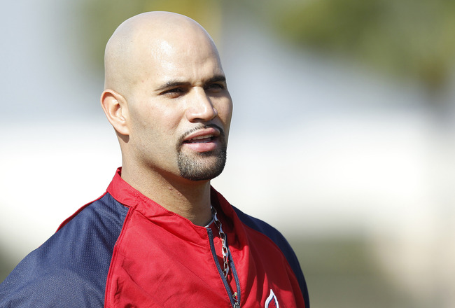 JUPITER, FL - FEBRUARY 17: Albert Pujols #5 of the St. Louis Cardinals  takes a rest during fielding practice at Roger Dean Stadium on February 17, 2011 in Jupiter, Florida. (Photo by Joel Auerbach/Getty Images)